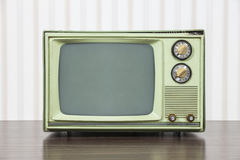 Grungy Green Vintage Television. Set on table Stock Image