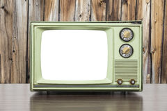 Grungy Green Vintage Television with Wood Wall and Cut Out Scree. Grungy green vintage television set with wood wall and cut out screen Royalty Free Stock Photos
