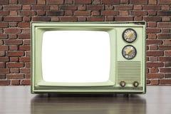 Grungy grünes Weinlese-Fernsehen mit Backsteinmauer und herausgeschnittenem Scre Lizenzfreie Stockfotografie