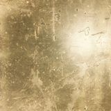 Grungy guld tonad industriell bekymrad asfalttextur Royaltyfri Foto