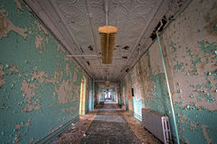 Grungy hallway in Hudson River State Hospital. Old hallway in an abandoned psychiatric hospital Royalty Free Stock Photos