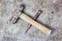 Grungy hammer and chisel. On rough concrete surface stock images