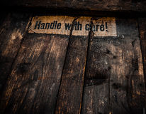 Grungy Handle With Care Sign Stock Image
