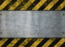 Grungy hazard sign metal plate. Great grungy hazard sign with metal plate background image Stock Image