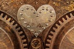 Grungy Hintergrund mit einem metallischen Herzen Stockbild