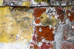 Grungy i brudna ścienna tekstura koloru żółtego i czerwieni Obrazy Royalty Free