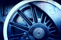 Grungy industrial wheel background. Concept closeup up of a gritty industrial wheel blue tint from steam train Royalty Free Stock Photo