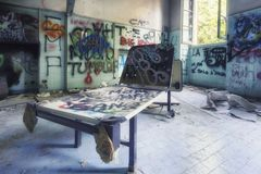 Grungy interior of abandoned hospital royalty free stock photo