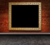 Grungy interior with antique frame Royalty Free Stock Photos