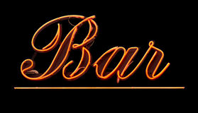 Neon Bar Sign. Grungy Isolated Neon Bar Sign Against Black Background stock images