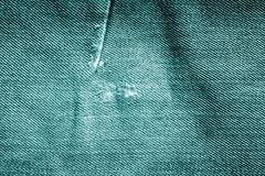 Grungy jeans cloth pattern in cyan tone. Stock Photo