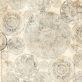 Grungy Lace Doiley Background Design. A grungy lace doiley background design texture montaged with old French receipt royalty free stock image