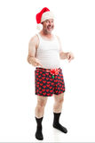 Grungy Looking Christmas Guy - Full Body Isolated. Grungy, unshaven middle aged man in his underwear, wearing a Santa hat and gesturing to his crotch. Full Body stock images