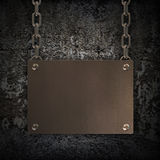 Grungy Metal Plate hanging on a chain Stock Photos