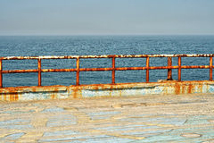 Grungy metal railings at the sea Royalty Free Stock Photography