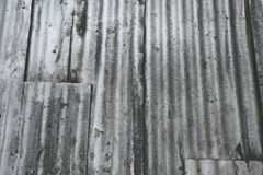 Grungy metal wall. Oil stained old corrugated metal wall panels Royalty Free Stock Image