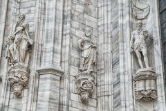 Grungy monuments at facade Stock Image