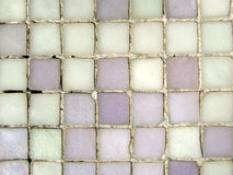 Grungy mosaic pattern. Grungy purple mosaic pattern close-up stock image
