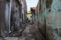 Grungy Back Alley. Grungy narrow dangerous looking barrio back alley Stock Images