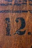 Grungy number 12. On an old church pew (more numbers are coming Stock Image