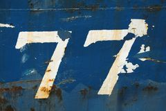Grungy number 77 Stock Image