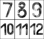 Grungy Numbers 7-12. Old rusty numbers (7-12) in greyscale with clipping path, grainy surface, XL size Royalty Free Stock Photo