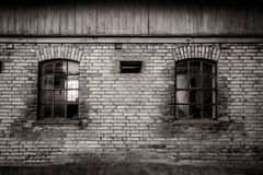 Grungy old barn windows. Grungy old barn with two broken windows Stock Photos