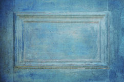 Grungy old blue door closeup. With Frame Royalty Free Stock Photography