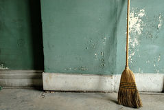 Grungy old building with broom Royalty Free Stock Images