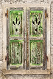 A Grungy old green wooden window Stock Photo