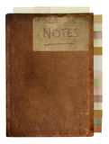 Grungy Old Notebook with Tabs. Isolated, worn out, marked and stained old brown leather notebook, labeled with the handwritten word 'Notes'. Tabbed index down royalty free stock photo