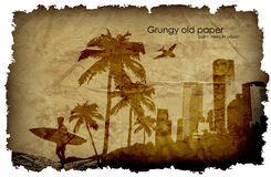 Grungy, old paper with a big city and windmills. Stock Photography