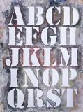 Grungy old stencil. With alphabet in capital letters vector illustration