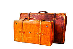 Grungy old suitcases. Two battered and grungy old suitcases Royalty Free Stock Photography