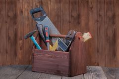 Grungy old tools on a wooden background.  Royalty Free Stock Image