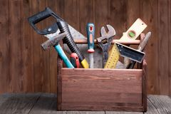 Grungy old tools on a wooden background.  Stock Photography