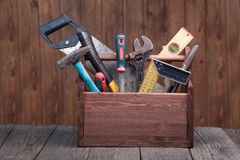 Grungy old tools on a wooden background front view. Royalty Free Stock Image