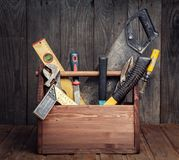 Grungy old tools on a wooden background front view. Stock Photos