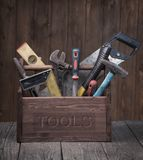 Grungy old tools on a wooden background front view. Stock Images