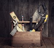 Grungy old tools on a wooden background front view. Grungy old tools on a wooden background. front view stock photo