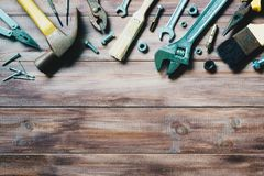 Grungy old tools on a wooden background. Grunge old tools on a wooden background royalty free stock image