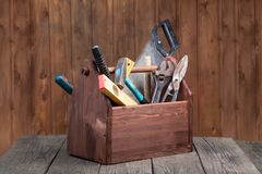 Grungy old tools on a wooden background.  Stock Images