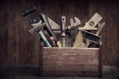 Grungy old tools on a wooden background.  royalty free stock images