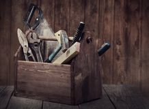 Grungy old tools on a wooden background royalty free stock photos