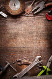 Grungy old tools on a wooden background Royalty Free Stock Image