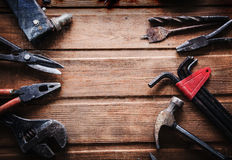 Grungy old tools on a wooden background Stock Photography