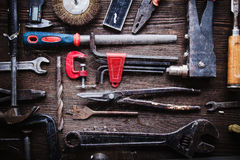 Grungy old tools on a wooden background Royalty Free Stock Photography
