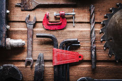Grungy old tools on a wooden background Stock Photos