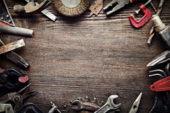 Grungy old tools on a wooden background Royalty Free Stock Images