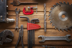 Grungy old tools on a wooden background Stock Images
